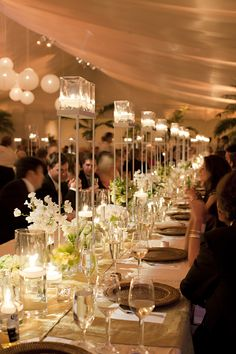 Get this look at your wedding with Candle Impressions Flameless Candles in elevated candle holders. These look great on the long table