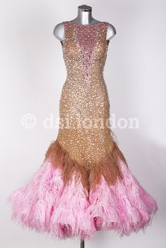 Feathered rose and tan colored gown with extensive stoning - DSI London. Visit http://ballroomguide.com/comp/attire/lady.html for more info about competition attire.