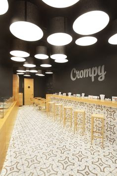 Crompy, in Prague, has been converted from an old bar into a bistro style restaurant with clean lines and bespoke oak furniture, designed by Czech firm TON.