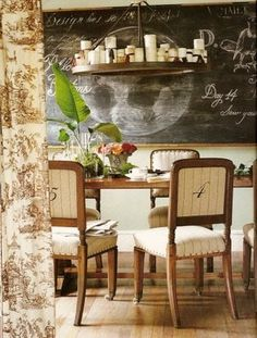"""French Country Dining Room...beautiful toile draperies, lovely ticking fabric chairs with numbered backs, """"candle""""abra, and cute chalkboard..."""