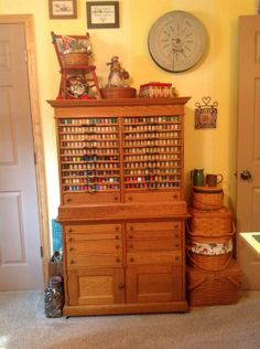 Love to have this antique spool cabinet in my sewing room