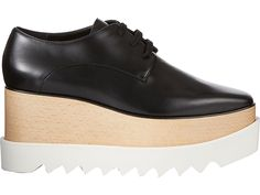"Stella McCartney Women's Britt Platform Oxfords by: Stella McCartney @Barneys New York (Global) Crafted of smooth black faux nappa leather, Stella McCartney's Oxford shoes are styled with a sustainable-wood platform and white chunky shark-tooth rubber sole. 2""/50mm platform, 25mm sole (approximately) Square toe, black flat laces Lace-up style Shark-tooth rubber sole Available in Black Vegan-friendly faux leather Made in Italy"