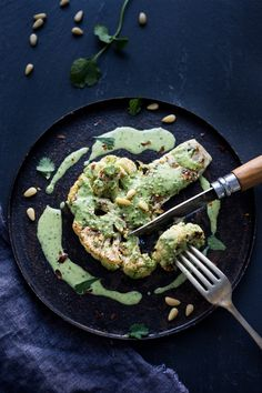 Zaatar Roasted Cauliflower Steaks with Green Tahini Sauce - a simple delicious vegan meal full of Middle Eastern flavor that can be made in 35 minutes. | www.feastingathome.com
