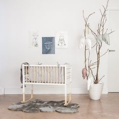 A simple and sweet nursery in natural tones with hints of grey and pink