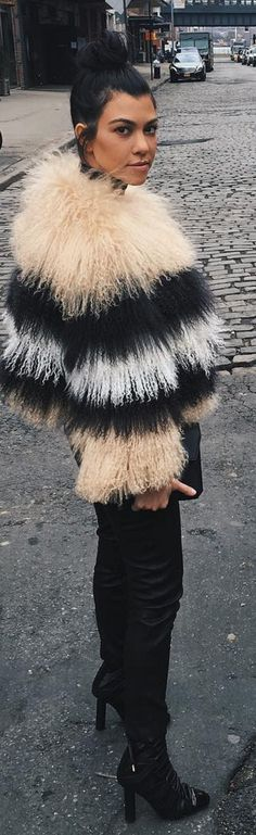 Who made Kourtney Kardashian's leather pants, black clutch handbag and tan stripe jacket?