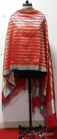 Beautifully woven Gold Zari in Pure Silk Banarsi Dupatta. Mix of Red &Gold makes it  perfect for any Festival /Party/ wedding/shagun. Directly from ArtisansIndian Traditional, Ethnic and Luxurious Shawls and Stoles at CraftsBazaar Made in India Online include Kashmiri Embroidert Pashmina Sozni, Kani, Papier Mache Shawls and Stoles, Jamavaar Shawls, Gujarati Kuttchi Shawls, Jaipuri Bandhani, Leheriya, Ajrakh and Block printing in silk, Chanderi, Maheshwari, Cotton and Wool.I...