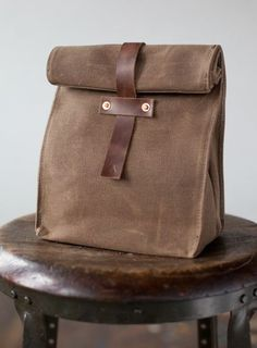 Be the talk of the office when you bring your lunch in this sturdy, waxed canvas lunch tote, hand...