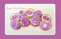Pretty Easter cookies, painted with inspiration from Pantone's 2014 Color of Year, 'Radiant Orchid'. These eggs and hibiscus flowers are bright and colorful for a fun Easter celebration! (Baked, designed, and painted by Krista Cook of Sugar Bee Cookies)
