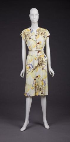 1940s print dress with interesting side detail via The Goldstein Museum of Design