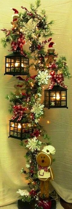 Christmas Decor, No Instructions....looks like a hook for plants....add lanterns.....flowers and a cute gingerbread