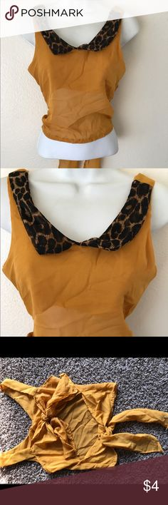 Mustard Yellow Vintage Crop Top Very different crop top with open back with two ties. Cute leopard collar. No brand and no tag. Looks like a medium. Tops Crop Tops
