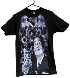 SALVADOR DALI SURREALISM T-Shirt:   MAD EMPEROR OF THE UNIVERSE, Salvador Dali, is at his best wielding chain munching ocelot while standing before his signature surrealist symbols of nudes, eyeballs and dripping time.  Printed on a soft black cotton tee.  Our unisex tees are 4.2 oz., preshrunk 100% combed ring-spun cotton.  Available Sizes: S, M, L, XL, 2XL, 3XL