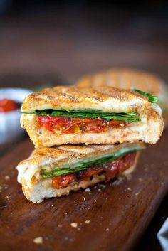Cheesy Hummus and Veggie Panini - This is the dreamiest vegetarian sandwich option I've ever come across! Creamy hummus, gooey cheese, and flavorful vegetables! Full recipe at theliveinkitchen.com