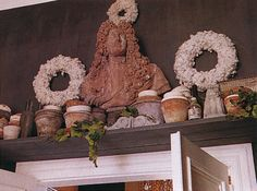 Terracotta pots & bust on shelf above doorway - Pieter Porters - Traditional Home, Holiday 1999