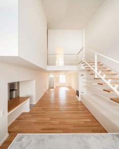 The interior of this house has been completely reorganised to create a large, open living space on the ground floor, with the bedrooms located on the new upper storey.