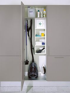 Cleaning closet storage cupboard for vacuum. The rest of the tall cupboards have large open space with a top shelf Cleaning Cupboard, Laundry Cupboard, Laundry Closet, Cleaning Closet, Cupboard Storage, Kitchen Storage, Kitchen Cupboard, Utility Room Storage, Utility Closet