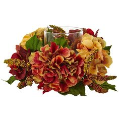 "Autumn Hydrangea Berry Candelabrum - Nothing says ""autumn"" quite like this beautiful candelabrum. Bursting with stunning fall hues, the hydrangea blooms surrounding the glass candelabrum will forever stay at ""peak"" color! Mixed in are some green leaves, and tiny berries, giving this a true ""home and hearth"" look. The best part? It'll stay looking fresh for years and years, meaning you'll enjoy it autumn after autumn. Number of Trunks: NA Number of Flowers: NA Number of Leaves: NA Pot Size…"