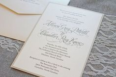 Script font on white and pearl
