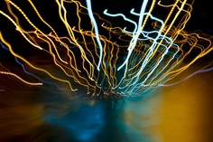 """""""Tree of Light"""" Picture of a rain soaked street, manually zoomed and panned on a long exposure."""