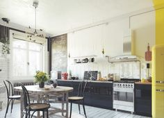 Round Wooden Dining Chair Yellow Refrigerator Pendant Light Oven Chimney Style Range Hood In Stainless Steel Yellow Accents Kitchen Black Cabinetry Wooden Chairs Scandinavian Kitchens: Ideas and Inspiration Kitchens schoolboy chairs classic SMEG urban jungle atmosphere Kateechen
