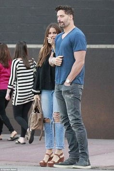 Linking arms: The couple were both casually dressed in distressed jeans for their lunch outing