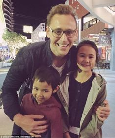 Fan favourite: Tom Hiddleston posed for photos with young fans on the Queensland Gold Coast