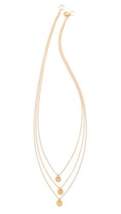 """This tiered, 18k gold-plated chain necklace features tiny hammered disc pendants. Ring clasp. 16"""" long."""