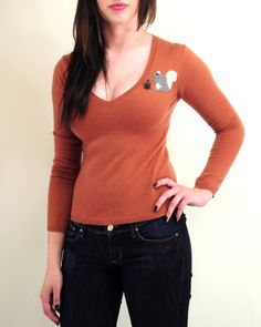 This fetching v-neck #cashmere sweater with a needle felted squirrel is a #chic piece to keep cozy this fall and winter!
