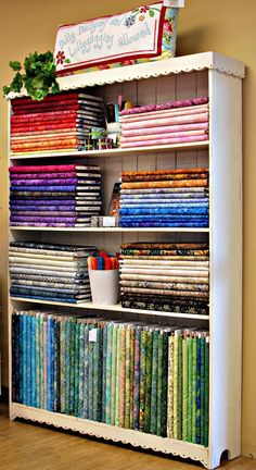 fabric storage inspo.  Get old bolts from the fabric store?  Esp. if doing wholesale.