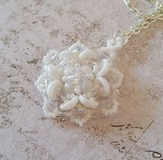 Hey, I found this really awesome Etsy listing at https://www.etsy.com/listing/245173781/snow-white-clover-pendant-white-lucky