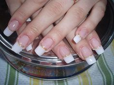 Wedding manicure with white nail polish at the free edge and  gold nail polish like an ornament