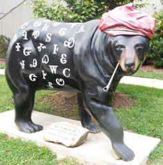 'Sequoyah SyllaBeary' - from The Painted Bear Trail in Cherokee, North Carolina;  at the Museum of the Cherokee Indian;  the headgear and pipe are the same as those worn by the real Sequoyah;  one of 19 fiberglass bears