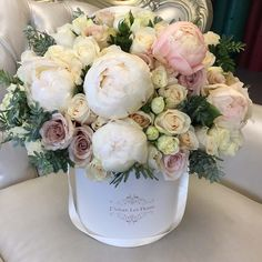 This breathtaking arrangement with white and beige roses, blush peonies, and just the right greens is perfect for the special recipient. Peony Arrangement, Beautiful Flower Arrangements, Silk Flowers, Floral Arrangements, Beautiful Flowers, Peonies Centerpiece, Tall Centerpiece, Centerpiece Wedding, Unusual Flowers