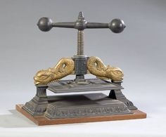 Cast iron book press with decorative dolphins