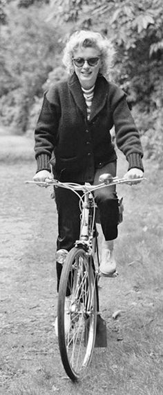 Marilyn cycling in Windsor Park, England, 1956.