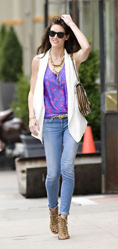 Hilary Rhoda wearing a floral print tank top, white vest, and jeans while out and about in NYC
