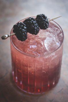 1 1/2 oz gin, 3/4 oz lemon juice, 1/2 oz simple syrup, 3/4 crème de mûre, blackberries for garnish