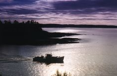 Boat under a purple sky, Five Islands, Georgetown, Maine. Photograph taken with film and filters by Geraldine Aikman.