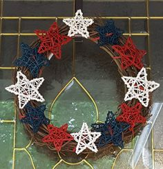 Primitive stick star wreath.  See more at www.facebook.com/LaLaLandWreaths/