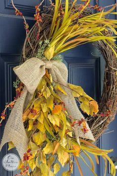 Make this DIY Fall Grapevine Wreath for your front door to instantly up your curb appeal! Welcome Autumn with the colors of the season and rustic elements.