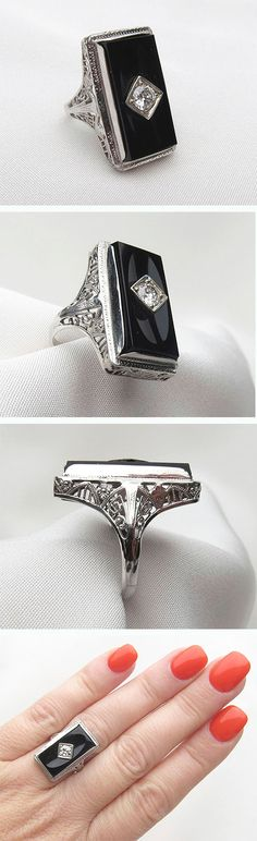 Circa 1930. This is a striking #ArtDeco 10KT #whitegold #filigreering centered by a bold rectangular #onyx stone. A diamond sparkles from the center of this vintage right hand ring.