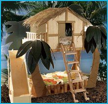 "Surf's up! Your child will love this Tropical Surf Shack Bunk Bed as they shimmy up the ladder or zoom down the slide. This tropical tree house theme bed features real bamboo, thatching, and palm tree inspired leaves to create the ultimate island experience. When disassembled the cottage fits through a 30""W or larger door frame. Bed size can be twin, full or queen, boys surfer dudes style bedroom design ideas - TROPICAL TREE HOUSE THEME BED"