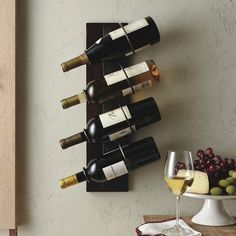 4-Bottle Wall Mount Wine Holder / Your storehouse of classic vintage makes a great show on the wall when mounted on the 4-Bottle Wall Mount Wine Holder. http://thegadgetflow.com/portfolio/4-bottle-wall-mount-wine-holder/