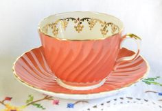 Fluted Aynsley Orange tea cup and saucer, molded tea cup, vintage aynsley