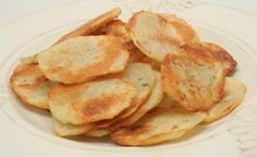 Baked Potato Chips  Preheat oven to 375 degrees. Cut potatoes into 1/8-inch thick slices by using either the slicing disc of a food processor, mandoline slicer, or by hand. Place potato slices in a large bowl. Add olive oil, salt, and pepper, and stir well to coat. Spread in a single layer on two large baking sheets. Bake 15 minutes. Flip potatoes, and cook another 10-15 minutes, or until chips are crispy.