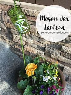 How to make a Mason Jar Lantern, a super simple project that adds a lot to a flower pot or garden.
