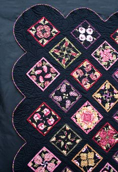 Midnight Garden. 4-Patch Stacked Posie Quilt. Love the black background and scalloped border. Posted by Peckish, 8-2-2013 on Quilting Board. Size: 296.5 KB