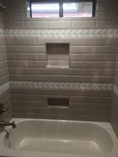 Subway with Sass! Take a look at this fun tub surround. The Bevel Pumice subway tile adds a whole new dimension. #bevelsubway #tubsurround https://arizonatile.com/en/products/porcelain-and-ceramic/bevel-subway