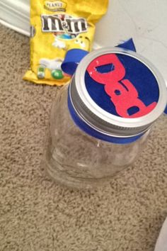 Looking for a cheap and simple gift for Father's Day (or mothers or anyone with substitution) well this is great. A mason jar and candy.