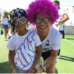 Playful Cristiano Ronaldo rocks a pink wig for a photo with his son